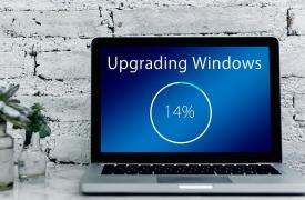 A laptop showing a Windows update at 14 per cent